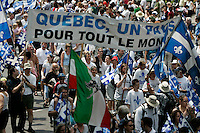 June 24 2005 File Photo, Montreal (Qc) Canada <br /> <br /> Quebecer of all ethnic origins take part in the SAint Jean-Baptiste (Quebec National Holliday) Parade in Old-Montreal, June 24, 2004<br /> <br /> Photo : (c) 2004, Pierre Roussel