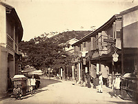 BNPS.co.uk (01202 558833)<br /> Pic: DominicWinterAuction/BNPS<br /> <br /> Wanchai.<br /> <br /> Revealed - A fascinating photo album from the very early days of British Hong Kong...long before the skyscrapers covered it over.<br /> <br /> The 150 year old photos of Hong Kong taken by one of the first British photographers to venture to the Far East have emerged for sale for £15,000.<br /> <br /> John Thomson, who was also a geographer, left Edinburgh for Singapore in 1862 and spent the following decade travelling the region.<br /> <br /> He explored a decidely low-rise Hong Kong from 1868 to 1870, taking numerous pictures of the rapidly expanding settlement and its industrious inhabitants.<br /> <br /> They capture the area, which is currently engulfed in unrest and protest, at a far more tranquil time.<br /> <br /> The photos are being sold with auction house Dominic Winter, of Cirencester, Gloucs.