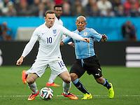 Wayne Rooney of England and Egidio Arevalo of Uruguay