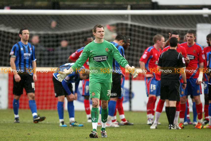 Chris Lewington of Dagenham and Redbridge leaves the pitch after being sent off -  Dagenham and Redbridge vs Cheltenham Town - at the London Borough of Barking and Dagenham Stadium - 18/02/12 - MANDATORY CREDIT: Dave Simpson/TGSPHOTO - Self billing applies where appropriate - 0845 094 6026 - contact@tgsphoto.co.uk - NO UNPAID USE.