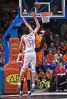 VALENCIA, SPAIN - 05/12/2014. Marjanovic del Estrella Roja y Dubljevic del Valencia Basket durante el partido. Pabellon Fuente de San Luis, Valencia, Spain.