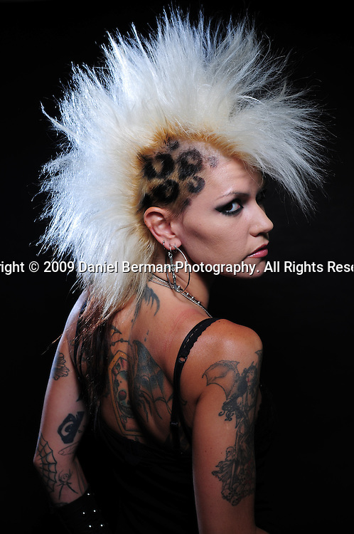 Alice Munn says her tattoos represent how her life has changed over the years from prim to punk. Here, she poses for a portrait on day one of the Seattle Tattoo Expo August 7, 2009 at Seattle Center.
