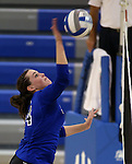 Marymount's Erin Allison gets a kill during a college volleyball match at Washington &amp; Lee University Lexington, Vir., on Saturday, Oct. 5, 2013.<br /> Photo by Cathleen Allison