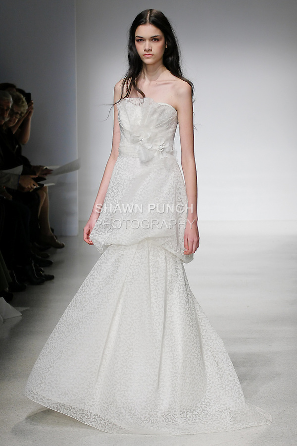 Model walks runway in a Petra wedding dress by Amsale Aberra, for the Christos Spring 2012 Bridal runway show.