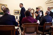Washington, DC - June 9, 2009 -- United States President Barack Obama listens to Press Secretary Robert Gibbs during a meeting with Senior Advisors in the Oval Office of the White House, June 9, 2009. .Mandatory Credit: Pete Souza - White House via CNP