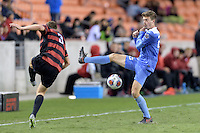 Houston, TX -  Friday, December 9, 2016: Jeremy Kelly (29) of the North Carolina Tar Heels blocks a kick by Tanner Beason (3) of the Stanford Cardinal  at the  NCAA Men's Soccer Semifinals at BBVA Compass Stadium.