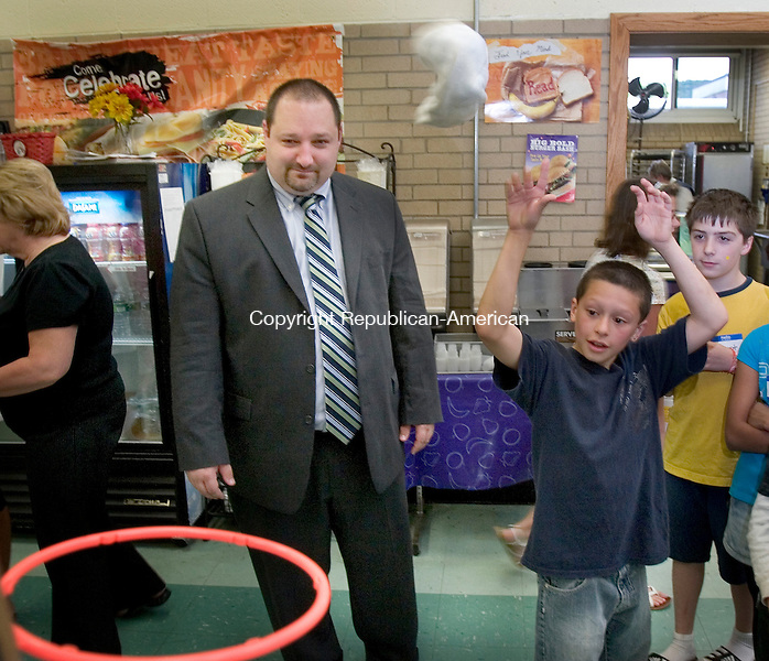 NAUGATUCK, CT. 09 May 2010-060910SV03--From left, Chris Montini, principal, checks out John Krupnik's, 12, Laundry Hoop at the invention convention at the Cross Street Intermediate School in Naugatuck Wednesday.<br /> Steven Valenti Republican-American