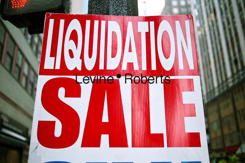 A liquidation sale is advertised in Midtown Manhattan in New York on Sunday, September 2, 2012. (© Richard B. Levine)