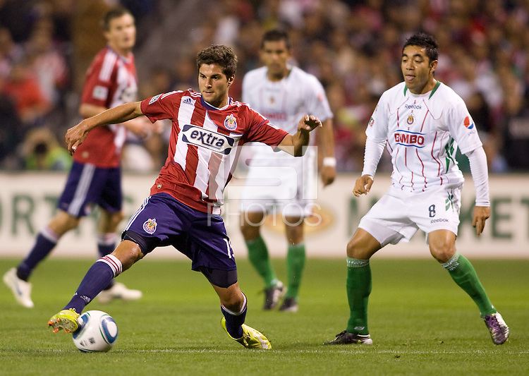 Chivas USA midfielder Sal Zizzo moves past Chivas de Guadalajara forward Marco Fabian. Chivas USA and CD Chivas de Guadalajara played to a 0-0 draw at Petco Park stadium in San Diego, California on Tuesday September 14, 2010.