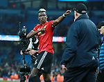Paul Pogba of Manchester United pumps his chest as he celebrates with the fans during the premier league match at the Etihad Stadium, Manchester. Picture date 7th April 2018. Picture credit should read: Simon Bellis/Sportimage