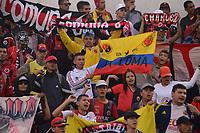 TUNJA - COLOMBIA, 26-01-2020:Hinchas del Cúcuta Deportivo  animan a su equipo durante partido entre Patriotas Boyacá  y Cúcuta Deportivo por la fecha 1 de la Liga BetPlay I 2020 jugado en el estadio La Independencia de la ciudad de Tunja. / Fans of Cucuta Deportivo cheer for their team during match between Patriotas Boyaca and Cucuta Deportivo for the date 1 as part of BetPlay League I 2020 played at La Independencia stadium in Tunja. Photo: VizzorImage / José Miguel Palencia / Cont /