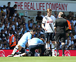 Tottenham's Eric Dier complains to referee Jonathan Moss after Southampton scored whilst Kyle Walker was injured during the Barclays Premier League match at the White Hart Lane Stadium.  Photo credit should read: David Klein/Sportimage