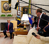 United States President Donald J. Trump listens to a reporter's question as he speaks to the media while meeting with His Royal Highness Prince Salman bin Hamad Al-Khalifa, Crown Prince, Deputy Supreme Commander, and First Deputy Prime Minister of the Kingdom of Bahrain in the Oval Office of the White House in Washington, DC on Monday, September 16, 2019.<br /> Credit: Chris Kleponis / Pool via CNP