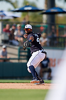 Detroit Tigers shortstop Willi Castro (49) throws to first base during a Grapefruit League Spring Training game against the Atlanta Braves on March 2, 2019 at Publix Field at Joker Marchant Stadium in Lakeland, Florida.  Tigers defeated the Braves 7-4.  (Mike Janes/Four Seam Images)