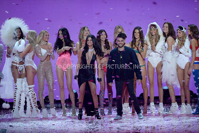 WWW.ACEPIXS.COM<br /> November 10, 2015 New York City<br /> <br /> Victoria's Secret models Candice Swanepoel, Adriana Lima, Behati Prinsloo, Lily Aldridge, Romee Strijd, Alessandra Ambrosio, Kate Grigorieva,Selena Gomez, The Weeknd walking the runway at the 2015 Victoria's Secret Fashion Show at Lexington Avenue Armory on November 10, 2015 in New York City.<br /> <br /> Credit: Kristin Callahan/ACE<br /> Tel: (646) 769 0430<br /> e-mail: info@acepixs.com<br /> web: http://www.acepixs.com