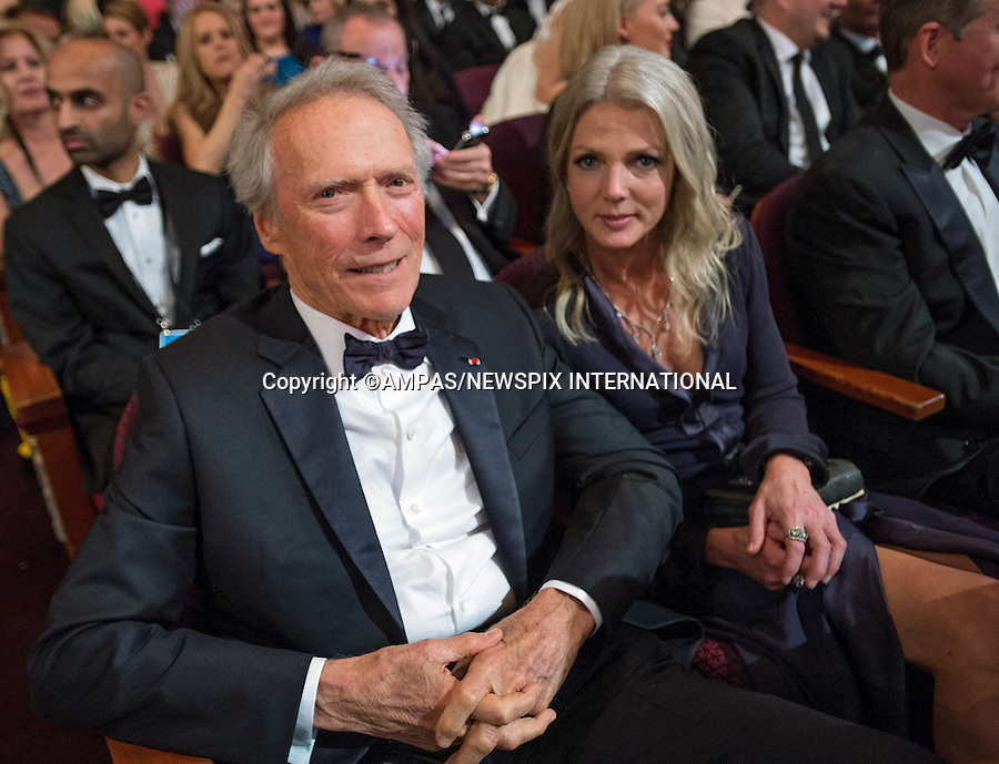 22.02.2015; Hollywood, California: 87TH OSCARS - CLINT EASTWOOD AND CHRISTINA SANDERA<br /> during the Annual Academy Awards Telecast, Dolby Theatre, Hollywood.<br /> Mandatory Photo Credit: NEWSPIX INTERNATIONAL<br /> <br />               **ALL FEES PAYABLE TO: &quot;NEWSPIX INTERNATIONAL&quot;**<br /> <br /> PHOTO CREDIT MANDATORY!!: NEWSPIX INTERNATIONAL(Failure to credit will incur a surcharge of 100% of reproduction fees)<br /> <br /> IMMEDIATE CONFIRMATION OF USAGE REQUIRED:<br /> Newspix International, 31 Chinnery Hill, Bishop's Stortford, ENGLAND CM23 3PS<br /> Tel:+441279 324672  ; Fax: +441279656877<br /> Mobile:  0777568 1153<br /> e-mail: info@newspixinternational.co.uk