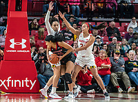 COLLEGE PARK, MD - FEBRUARY 9: Arella Guirantes #24 of Rutgers pulls around Blair Watson #22 and Stephanie Jones #24 of Maryland during a game between Rutgers and Maryland at Xfinity Center on February 9, 2020 in College Park, Maryland.