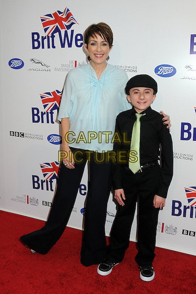 Patricia Heaton, Atticus Shaffer.BritWeek 2012 Official Launch held at a Private Residence, Los Angeles, California, USA..April 24th, 2012.full length black shirt trousers green tie blue blouse.CAP/ADM/BP.©Byron Purvis/AdMedia/Capital Pictures.