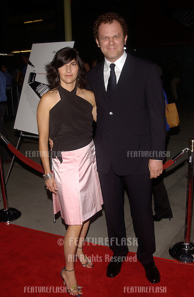 Actor JOHN C. REILLY & wife at the Los Angeles premiere of his new movie Criminal..August 30, 2004