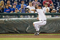 Virginia Cavaliers third baseman Kenny Towns (9) fields a ground ball during the NCAA College baseball World Series against the Florida Gators on June 15, 2015 at TD Ameritrade Park in Omaha, Nebraska. Virginia defeated Florida 1-0. (Andrew Woolley/Four Seam Images)