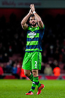 Jordi Amat of Swansea City  celebrates after the final of the the Barclays Premier League match between Arsenal and Swansea City at the Emirates Stadium, London, UK, Wednesday 02 March 2016
