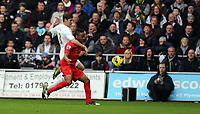 Sunday, 25 November 2012<br /> Pictured: Ben Davies (L) and Raheem Sterling, <br /> Re: Barclays Premier League, Swansea City FC v Liverpool at the Liberty Stadium, south Wales.