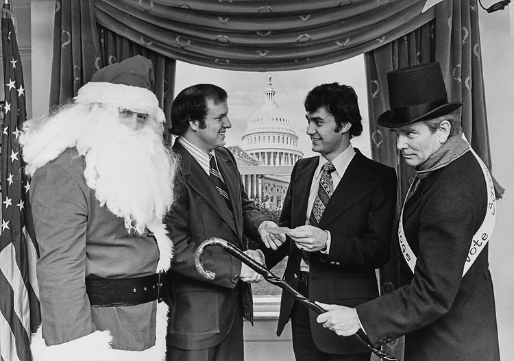 Congressmen with Santa Claus around Christmas event on Capitol Hill. (Photo by Dev O'Neill/CQ Roll Call via Getty Images)