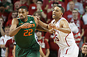 December 4, 2013: Walter Pitchford (35) of the Nebraska Cornhuskers defending against Donnavan Kirk (22) of the Miami (Fl) Hurricanes at the Pinnacle Bank Areana, Lincoln, NE. Nebraska defeated Miami 60 to 49.