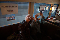 Actor Lenny Clarke (left), longtime friend and supporter of Senator Scott Brown, poses for a picture with volunteer Donya Platt, of Acton, on the Brown campaign bus between campaign stops in Framingham and Lowell, Massachusetts, USA, on Thurs., Nov. 2, 2012. Senator Scott Brown is seeking re-election to the Senate.  His opponent is Elizabeth Warren, a democrat.