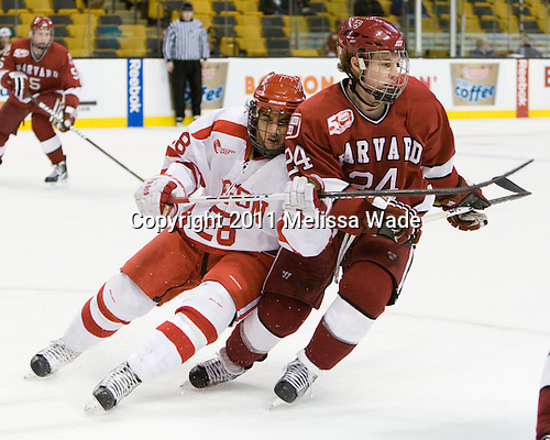 Sahir Gill (BU - 28), Luke Greiner (Harvard - 24) - The Harvard University Crimson defeated the Boston University Terriers 5-4 in the 2011 Beanpot consolation game on Monday, February 14, 2011, at TD Garden in Boston, Massachusetts.