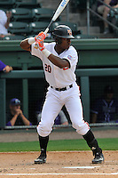 Center fielder Kyle Lewis (20) of the Mercer Bears bats in a SoCon Tournament game against the Furman Paladins on Thursday, May 26, 2016, at Fluor Field at the West End in Greenville, South Carolina. The catcher is Bret Huber. Mercer won, 6-1. Lewis is considered a 2016 Top 5 draft pick. (Tom Priddy/Four Seam Images)
