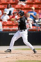Third baseman Bobby Spain (38) of the Hickory Crawdads follows through on his swing versus the Charleston RiverDogs at L.P. Frans Stadium in Hickory, NC, Sunday, May 4, 2008.