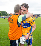 Donal Moloney, Clare joint manager, gives Conor Cleary of Clare a hug following their Munster  championship round robin game win over Waterford at Cusack Park Photograph by John Kelly.