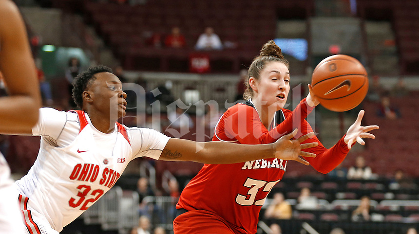 Ohio State Buckeyes forward Shayla Cooper (32) applies tight pressure as the inbounding Cornhuskers try to get the ball to Nebraska Cornhuskers forward Jessica Shepard (32) in the first half at Value City Arena on February 18, 2016.  (Chris Russell/Dispatch Photo)