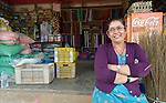 "Gita Giri sits in front of her shop in Adamtar, a village in the Dhading District of Nepal. Dan Church Aid, a member of the ACT Alliance, has provided food, shelter, livelihood, winterization assistance and a variety of other support to indigenous villagers here in the wake of a devastating 2015 earthquake. Giri was chosen by her neighbors to sell warm clothes, blankets and shelter materials which they could purchase with cash vouchers provided by the ACT Alliance. Giri made no profit on the sales. ""With people from around the world assisting our community, how could I make a profit on those supplies?"" she asked."