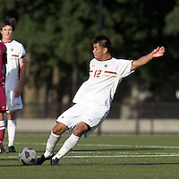 Boston College defender/forward Kevin Mejia (12) passes the ball. Boston College defeated Harvard University, 2-0, at Newton Campus Field, October 11, 2011.
