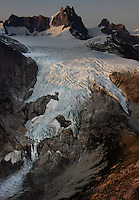 Glaciers melting in the Stikine Icefield form waterfalls off of Devil's Thumb in the wilderness region east of Petersburg, Alaska.
