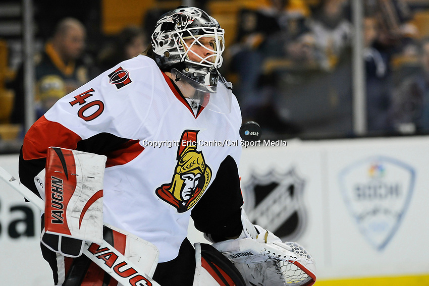 February 8, 2014 - Boston, Massachusetts, U.S. - Ottawa Senators goalie Robin Lehner (40) stops a puck during the warm up period at the NHL game between the Ottawa Senators and the Boston Bruins held at TD Garden in Boston Massachusetts.   Eric Canha/CSM