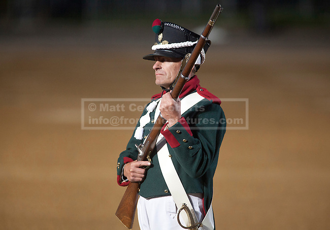 13/06/2012. LONDON, UK. A re-enactor of the 'Moscow Militia' stands ready to fire his musket during a performance of Tchaikowsky's '1812 Overture' at the annual Beating Retreat parade at Horse Guards Parade in London. On two successive evenings each year in June a pageant of military music, precision drill and colour takes place on Horse Guards Parade in the heart of London when the Massed Bands of the Household Division carry out the Ceremony of Beating Retreat. 300 musicians, drummers and pipers perform this age-old ceremony. The Retreat has origins in the early days of chivalry when beating or sounding retreat pulled a halt to the days fighting. Photo credit: Matt Cetti-Roberts