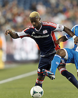 Under pressure, New England Revolution substitute forward Dimitry Imbongo (92) dribbles. In a Major League Soccer (MLS) match, the New England Revolution (dark blue) defeated Philadelphia Union (light blue), 5-1, at Gillette Stadium on August 25, 2013.