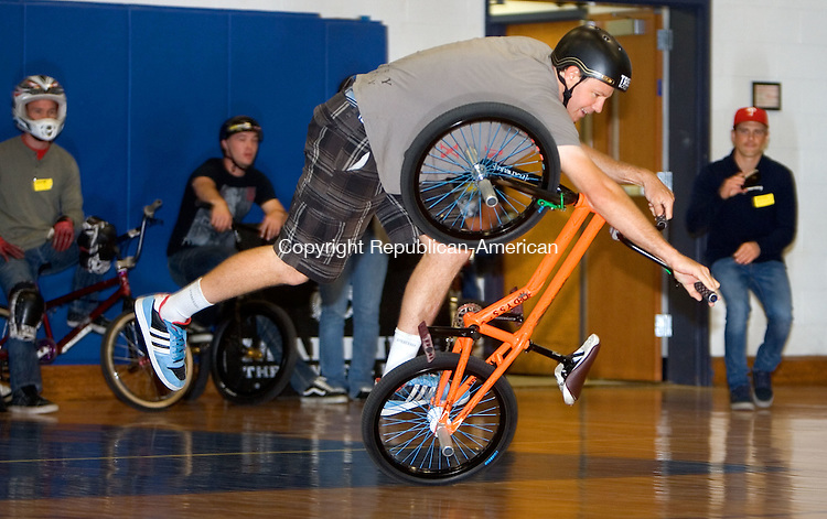 SEYMOUR, CT. 01 May 2012-050112SV02-Trevor Meyer of Minneapolis, MN. does a a trick on his bike in the gym at Seymour High in Seymour Tuesday. The X-Games athletes performed at the school as part of the Campaign for Tobacco-Free Kids. The group was talking about the negative aspects of tobacco and how the market targets youth..Steven Valenti Republican-American