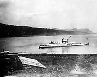 BNPS.co.uk (01202 558833)<br /> Pic Lawrences/BNPS<br /> <br /> B3 submarine near Burnt Island in the Firth of Forth.<br /> <br /> Fascinating early photos of submarine warfare featuring close quarters views of German battleships have come to light 100 years later.<br /> <br /> The photo albums were collated by British Commander Maurice Bailward who documented every stage of his naval career.<br /> <br /> Cmdr Bailward attended Royal Naval College in Osborne, Isle of Wight, from 1906 and 1908, the same time as Edward, the Prince of Wales.<br /> <br /> He was involved in many of the major sea battles of World War Two as well as the British effort to help the Whites during the Russian Civil War of 1919.<br /> <br /> The albums have emerged for sale at auction from a family descendant with Lawrences Auctioneers, of Crewkerne, Somerset.