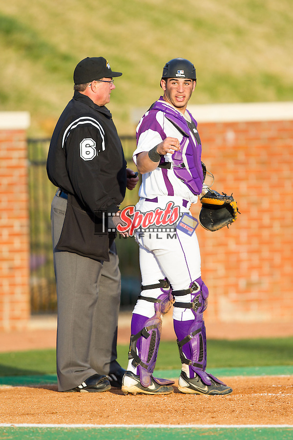 High Point Panthers catcher Josh Spano (21) looks to the dugout for the sign during the game against the Coastal Carolina Chanticleers at Willard Stadium on March 14, 2014 in High Point, North Carolina.  The Panthers defeated the Chanticleers 3-0.  (Brian Westerholt/Sports On Film)