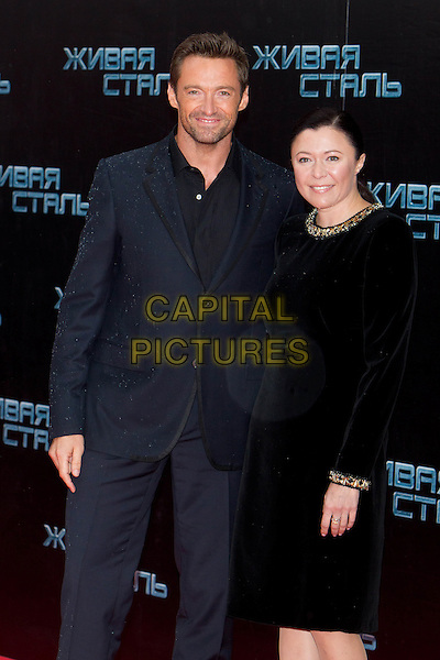 "Hugh Jackman, Shawn Levy.At the Premiere of ""Real Steel"", Moscow, Russia, 8th September 2011..half length grey gray suit hands in pockets black white shirt tie  navy blue .CAP/PER/SB.©SB/PersonaStars/Capital Pictures."