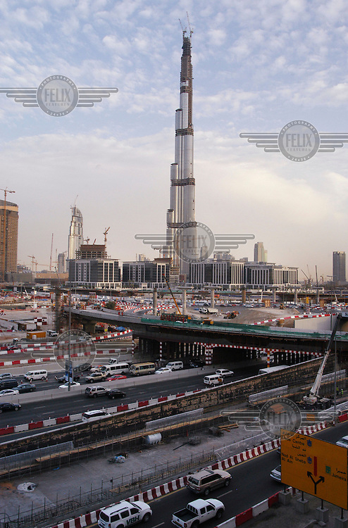 Sheikh Zayed Road and the Burj Khalifa during its construction. When finished it became the world's tallest building (828 metres, 2,716.5 feet).