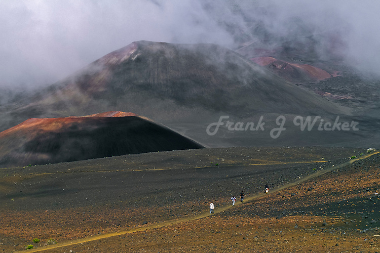 Male and female hikers in HALEAKALA NATIONAL PARK on Maui in Hawaii