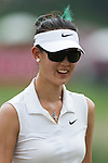 CHON BURI, THAILAND - FEBRUARY 16:  Michelle Wie of USA smiles after a putt on the 8th green during day one of the LPGA Thailand at Siam Country Club on February 16, 2012 in Chon Buri, Thailand.  Photo by Victor Fraile / The Power of Sport Images