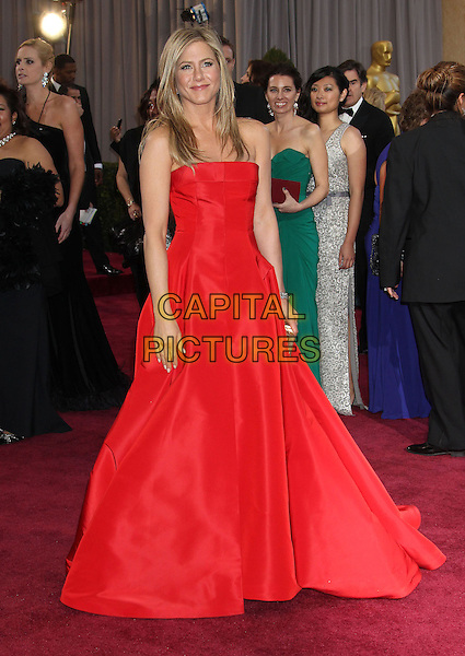 Jennifer Aniston (wearing Valentino).85th Annual Academy Awards held at the Dolby Theatre at Hollywood & Highland Center, Hollywood, California, USA..February 24th, 2013.oscars full length red strapless dress gown gold clutch bag.CAP/ADM/RE.©Russ Elliot/AdMedia/Capital Pictures.