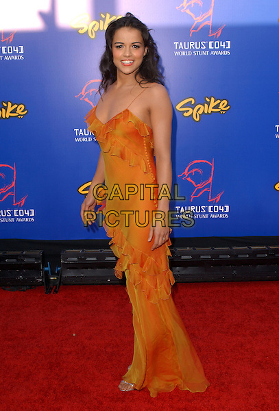 MICHELLE RODRIGUEZ.The 4th Annual Taurus World Stunt Awards held at The Paramount Picture Studios in Los Angeles California .May 16,2004.full length, full-length, orange dress, spaghetti straps, ruffles.www.capitalpictures.com.sales@capitalpictures.com.©Capital Pictures