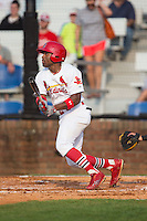Malik Collymore (15) of the Johnson City Cardinals follows through on his swing against the Bristol Pirates at Howard Johnson Field at Cardinal Park on July 6, 2015 in Johnson City, Tennessee.  The Pirates defeated the Cardinals 2-0 in game one of a double-header. (Brian Westerholt/Four Seam Images)